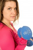 Portrait of a female model lifting blue barbells — Stock Photo