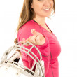 American football helmet helb by a young female model — Stock Photo #66845259