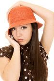 Pretty Asian American teen girl model wearing an orange hat — Stock Photo