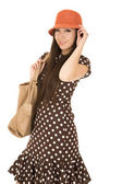 Cute teen girl model wearing a polka dot dress and orange hat — Foto de Stock
