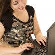 Cute female student using laptop computer smiling — Stock Photo #68806407