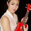 Asian American teen beauty holding her red ukulele — Stock Photo #68806477