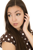 Attractive Asian American woman portrait glancing backwards hand — Stock Photo