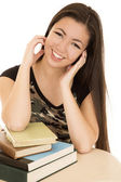 Cute teen model sitting with school books smiling — Stock Photo