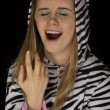 Close up portrait of a young woman yawning in cat pajamas — Stock Photo #69966647
