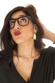 Funny expression woman puckered lips looking up wearing geek gla — Stock Photo