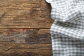 Folded tablecloth on wooden table  — Stock Photo