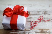 Boxed gift on wooden background — Stock Photo
