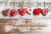 Fabric hearts on a wooden background — Stock Photo