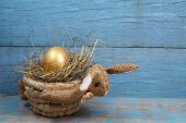 Rabbit-shaped basket with egg  — Stock Photo
