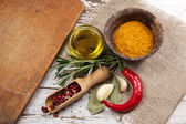 Spices with cutting board — Stock Photo