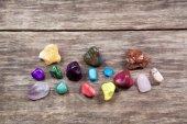 Stones on wooden table — Stock Photo