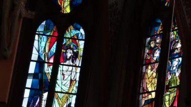 Large stained glass windows in the church — Stock Video