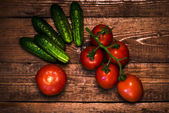 Tomatoes and cucumbers on the table — Stock Photo