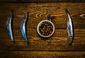 Grain pepper and fish on the table — Stock Photo
