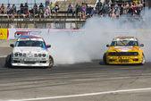 Drift cars  brand BMW overcome turn track — Stock Photo