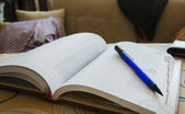 A home notebook with pen — ストック写真