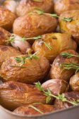 Roasted potatoes with garlic — Stock Photo
