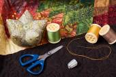 Accessories for patchwork on a quilt — Stock Photo