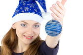 Image of woman with christmas balls in hat — Stok fotoğraf