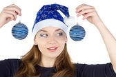 Image of young woman looking at christmas balls — Stok fotoğraf