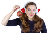 Photo of woman in winter headphones with ball — Stok fotoğraf