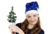 Photo of woman with small christmas tree — Stockfoto