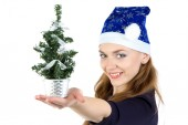 Woman with the small christmas fir tree — Stockfoto