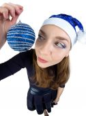Young woman looking at the christmas ball — Stockfoto