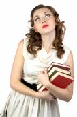 Photo of the dreaming woman with books — Stock Photo