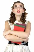 Pinup young woman with books looking up — Stock Photo