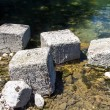 Photo of square stones among water — Stock Photo #79287858