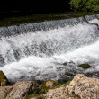 Photo of foaming flowing water among stones — Stock Photo #79288560