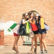 Group of happy friends with shopping bags taking a selfie in the city center - Girlfriends walking and having fun in the summer around the old town - University students during a break in a sunny day — Stock Photo #52782551