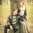 Modern fashion hipster couple of young lovers with autumn clothes - Deep moment at the beginning of a love story with a nostalgic desaturated filtered look — Stock Photo #53658917