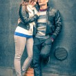 Modern fashion hipster couple of young lovers with autumn clothes ready for the upcoming winter - Deep moment of a love story with a cold vintage filtered look — Stock Photo #53658933