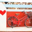 """Red vintage bicycle with """" I Love """" paint — Stock Photo #53658965"""