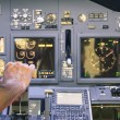 Постер, плакат: Captain hand accelerating on the throttle in commercial airliner flight simulator Cockpit thrust levers on the phase of takeoff