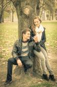 Modern fashion hipster couple of young lovers with autumn clothes - Deep moment at the beginning of a love story with a nostalgic desaturated filtered look — Stockfoto