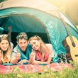 Group of best friends with thumbs up having fun camping together - Concept of carefree youth and freedom outdoors in the nature during vacations - Vintage filtered look — Stock Photo #54622071