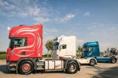 RIMINI, ITALY - SEPTEMBER 7, 2014: Scania semitrucks parked along the beach promenade in Rivazzurra, Adriatic Coast. Scania Aktiebolag is a major Swedish industry manufacturer of commercial vehicles. — Stock Photo