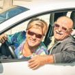 Happy senior couple ready for driving a car on a journey trip - Concept of joyful active elderly lifestyle with man and woman enjoying their best years — Stock Photo #55299111