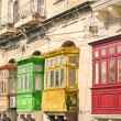 Vintage view of typical buildings balconies in La Valletta  - Colorful travel in Malta on the road - Popped up filtered version — Stock Photo #55299119