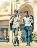 Young business men in the city main square with smartphone having a break after a working day texting sms messages - Modern concept of urban and metropolitan life on a vintage filtered look — Stock Photo