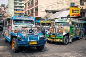 BAGUIO, PHILIPPINES - FEBRUARY 4, 2014: colorful jeepneys at the bus station of the city of Baguio. Inspired from US military jeeps, those are the cheapest and kitschest transportation in the country. — Stock Photo