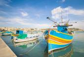 Colorful typical boats in Marsaxlokk - Mediterranean traditional fisherman village in the south east of Malta — Stock Photo