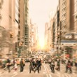 People on the street on Madison Avenue in Manhattan downtown before sunset in New York city - Commuters walking on zebra crossing during rush hour in american business district — Stok fotoğraf #56174077