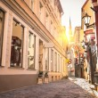 Vintage retro travel image of a narrow medieval street in old town Riga at sunset - Latvia - European capital of culture 2014 — Stock Photo #56719641
