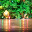 Detail of Christmas tree decorations with lights reflections on the floor - Cropped composition for holidays background — Stock Photo #56719681