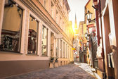 Vintage retro travel image of a narrow medieval street in old town Riga at sunset - Latvia - European capital of culture 2014 — Stock Photo